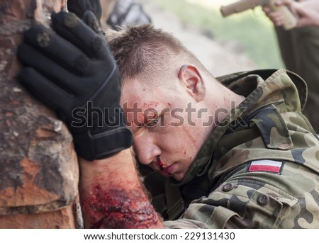 SZCZECIN, POLAND - MAY 31, 2014: Wounded Soldier in Polish Army uniform during  Historical reenactment - stock photo