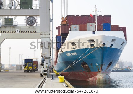 Szczecin, Poland-November 2016: unloading of containers at the seaport of a merchant ship