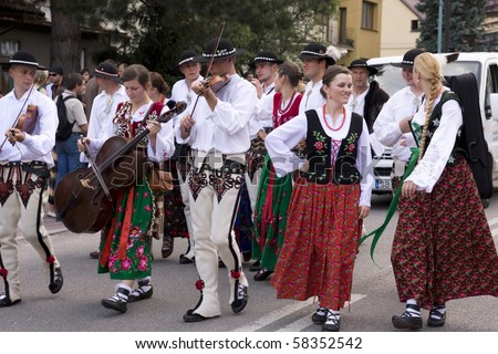 SZCZYRK, POLAND–AUGUST 1: Participants of the 47th Beskidy Highlanders Week of Culture (TKB), the biggest folk culture event in Eastern Europe, parade through the city, folk group from Poland on August 1, 2010 in Szczyrk, Poland