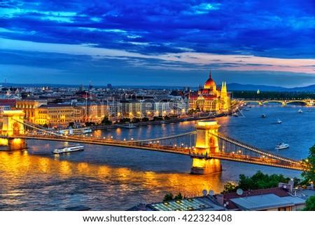 Szechenyi Chain Bridge and Parliament at dusk. Budapest, Hungary. - stock photo