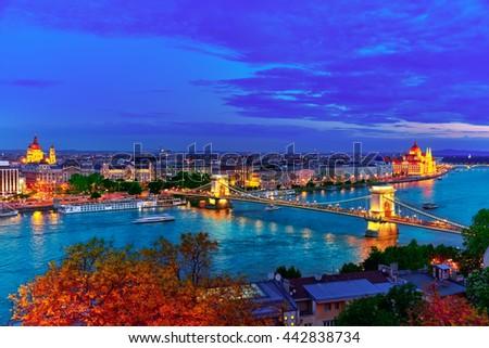 Szechenyi Chain Bridge and Parliament at dusk from Fisherman Bastion. Budapest, Hungary. - stock photo
