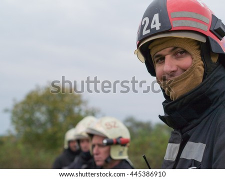 Szeged, Algyo, Hungary - October 8, 2015: Regional fire-fighting exercise in the training area with urban and contract firefighters.  Fire-fighting commanders prepared for practice.