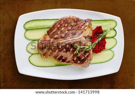 T-bone on cucumber bed - isolated