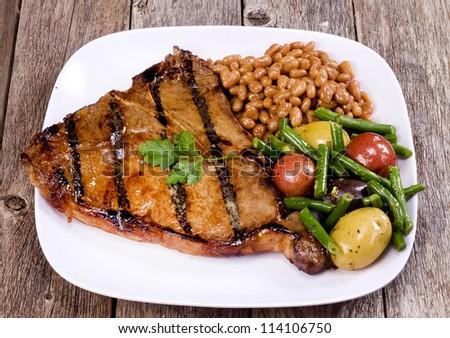 T-Bone Steak and Vegetables. - stock photo