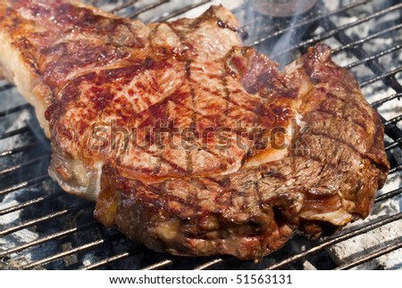 T-bone steak grilled on a barbecue