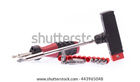 T-shape screwdriver metal bits set with plastic handle isolated on white background - stock photo