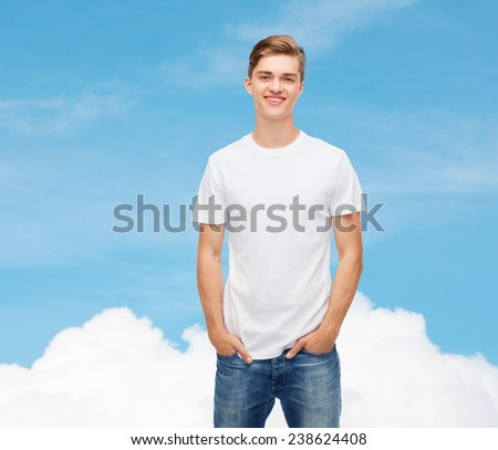 t-shirt design, advertising, dream and people concept - smiling young man in blank white t-shirt over blue sky background - stock photo