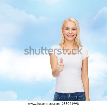 t-shirt design and happy people concept - woman in blank white t-shirt showing thumbs up - stock photo