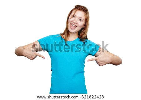 t-shirt design concept. Excited happy young woman pointing to empty space on her blue t-shirt with both hands, isolated on white - stock photo
