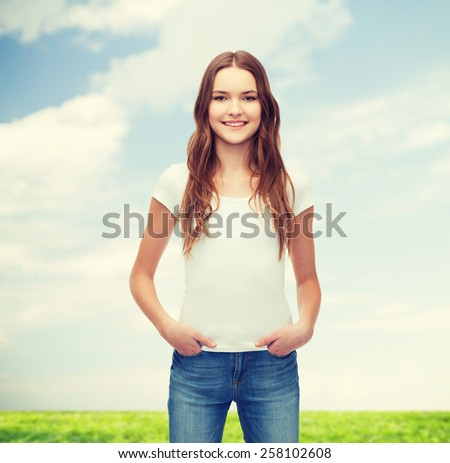 t-shirt design concept - smiling teenager in blank white t-shirt - stock photo