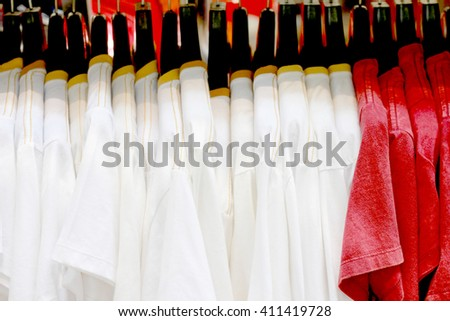 T-shirt hanging on a hanger - stock photo