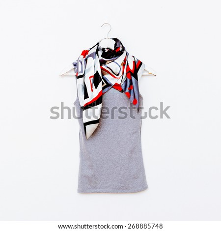 T-shirt on hanger with bright Scarf. Fashion clothing - stock photo