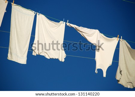 T- shirts hanging on a drying line - stock photo