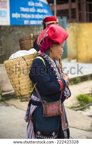TA PHIN, LAO CAI, VIETNAM - SEP 21, 2014: Unidentified Red Dao  woman in a red turban in the Ta Phin village. Red Dao is one of the minority ethnic groups in Vietnam