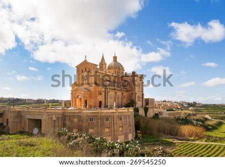 Ta' Pinu Church in village Gharb, Gozo island, Malta. The famous Madonna church is dedicated to the Blessed Virgin of Ta' Pinu. - stock photo