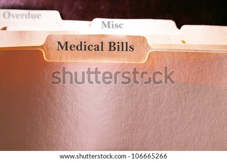 tabbed folders with Medical Bills text