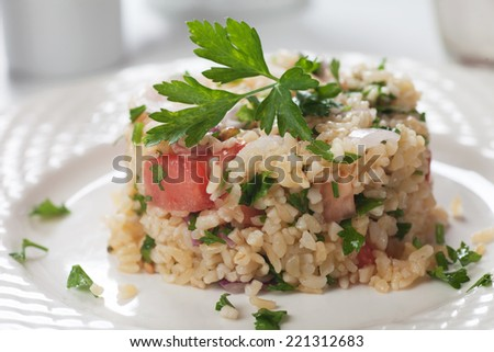 Tabbouleh, middle eastern salad with bulgur wheat, parsley and tomato