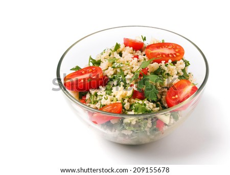 Tabbouleh with couscous and parsley, healthy salad in glass bowl on white background - stock photo