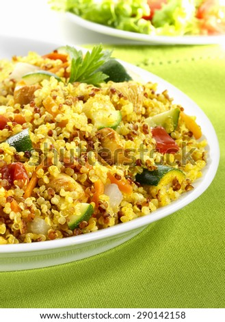 Tabbouleh with quinoa and vegetables on white plate - stock photo