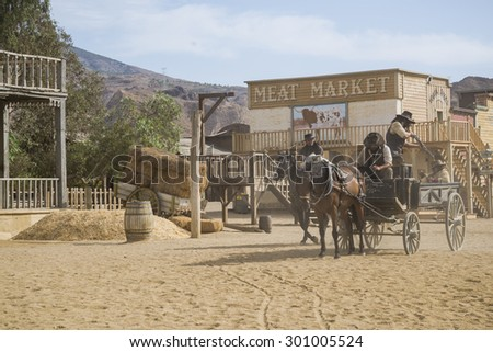 TABERNAS DESERT, ALMERIA, SPAIN - September 19, 2014: filming a western movie. Carrying an arrested criminal to the sheriff office. Wild west town set. - stock photo