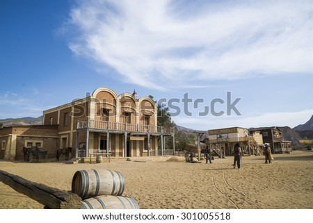 TABERNAS DESERT, ALMERIA, SPAIN - September 19, 2014: filming cowboy duel for a western movie. Wild west town set. - stock photo