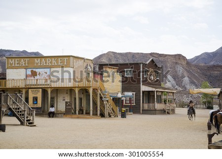 TABERNAS DESERT, ALMERIA, SPAIN - September 19, 2014: filming western movie. Wild west town set. - stock photo
