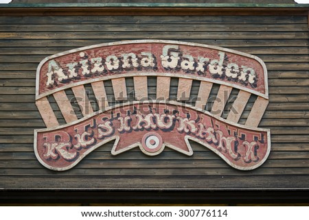 TABERNAS DESERT, ALMERIA, SPAIN - September 19, 2014: Old western town wooden typographic restaurant sign - stock photo