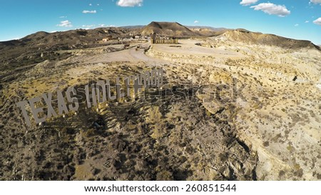 TABERNAS, SPAIN - February 18: Aerial View of a welcome sign TEXAS HOLLYWOOD in Fort Bravo/Texas on February 18, 2015 in Tabernas, Spain. Fort Bravo is the biggest backlot of western style in Europe - stock photo