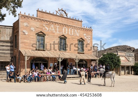 TABERNAS, SPAIN - OCT 17, 2015: VIsitors at the Fort Bravo Texas Hollywood western style theme park in the Province of Almeria, Spain