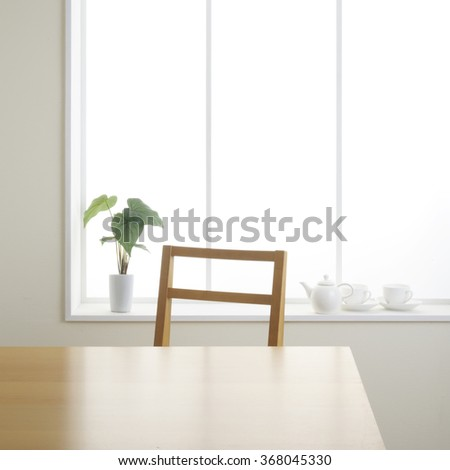 table and chair in the room. - stock photo