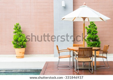 Table and chair with white umbrella outdoor patio