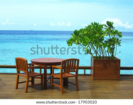 Table And Chairs At Seaside - stock photo