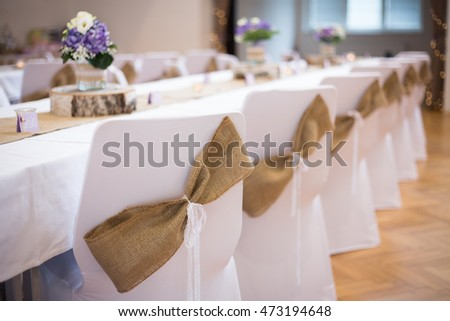 Table and chairs decorated for the wedding party