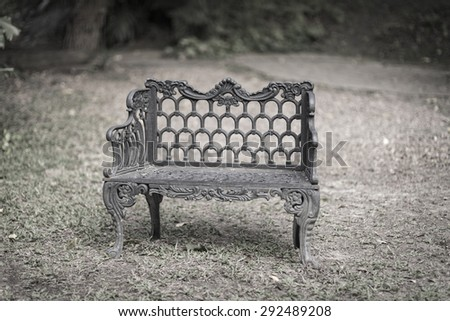 table and chairs in beautiful garden. Vintage style pictures. - stock photo