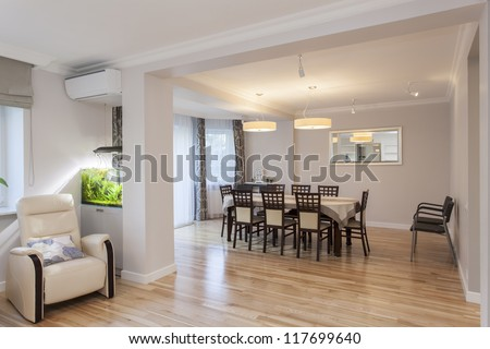 Table and chairs in elegant dining room - stock photo