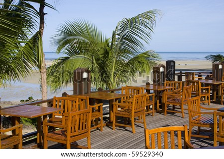 Table and chairs in empty cafe at island Koh Chang , Thailand .