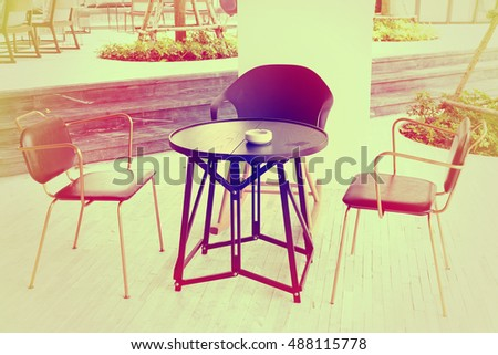 Table and chairs in garden.