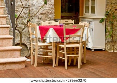 Table and chairs in Italy - country style - stock photo