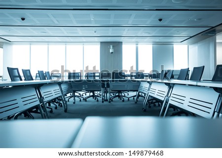 Table and chairs in meeting room. - stock photo