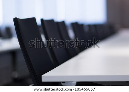 Table and chairs in meeting room.