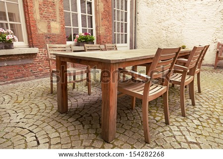 Table and chairs in patio, vintage style  - stock photo