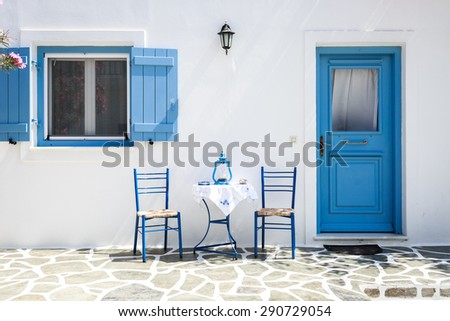 Table and chairs in the streets of Antiparos, Greece - stock photo