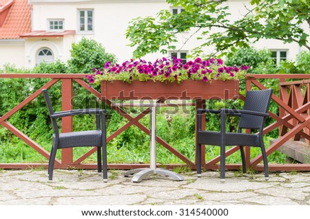 Table and chairs of modern european outdoor cafe - stock photo