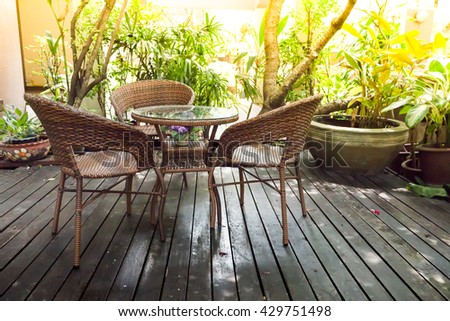 table and chairs standing at the garden