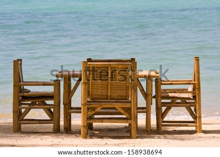 Table and chairs with a beautiful sea view on island Koh Phangan, Thailand.