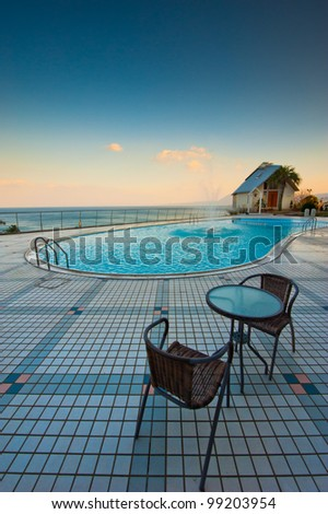 Table and chairs with  sunset - stock photo
