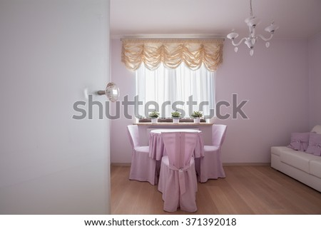 Table and covered chairs in rose interior