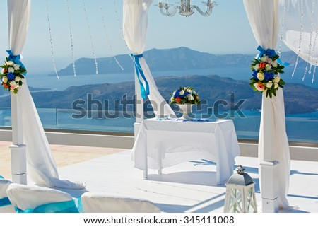 Table and decorations for the wedding ceremony on the beach. Greece, Santorini.