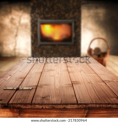 table and fireplace  - stock photo