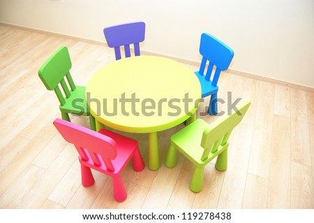 Table and five chairs in Kindergarten Preschool Classroom - stock photo